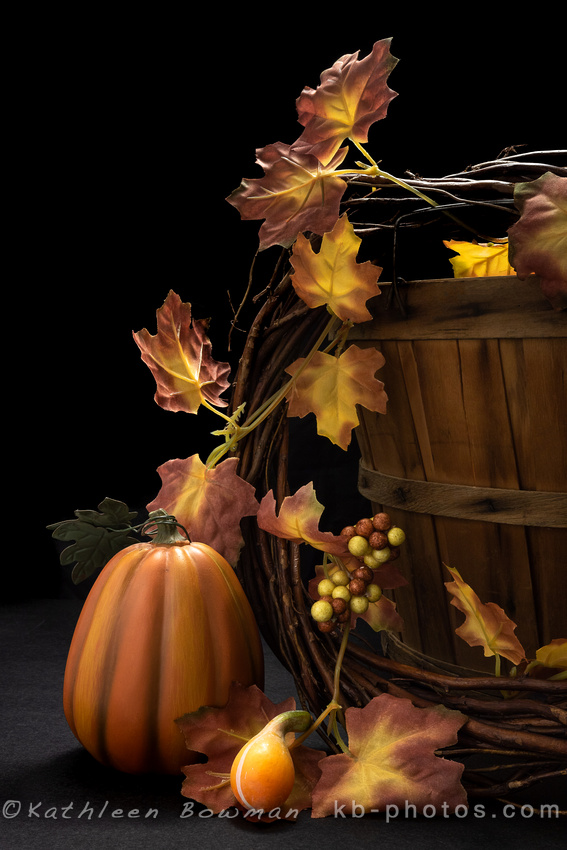 Autumn scene with apple basket, decor pumpkin, and leaves on black background